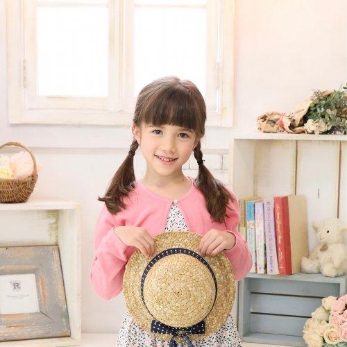 Clara holding hat